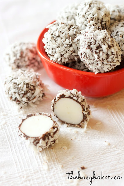red bowl filled with sweet potato truffles rolled in shredded coconut