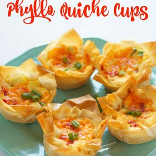 titled photo (and shown): Roasted Red Pepper Phyllo Quiche Cups (on a green plate)