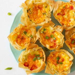 platter of roasted red pepper quiche cups made with phyllo pastry dough