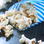 sweet and salty kettle corn in a blue and white striped bag