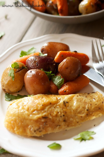 roast chicken and potatoes on a dinner plate