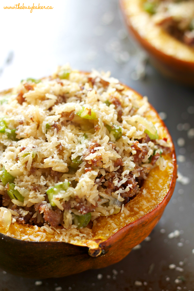 This Italian Sausage and Brown Rice Stuffed Acorn Squash is a deliciously healthy easy weeknight meal idea made with sausage, whole grain rice, and seasonal veggies! Recipe from thebusybaker.ca! #stuffedacornsquash #italiansausagestuffed #easyweeknightmeal