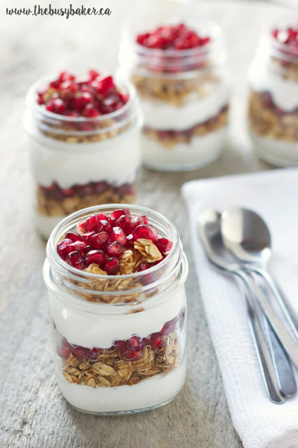 gluten free granola parfaits layered with pomegranate arils, gluten free granola and Greek yogurt