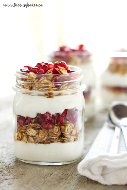 a granola and yogurt breakfast parfait served in a mason jar