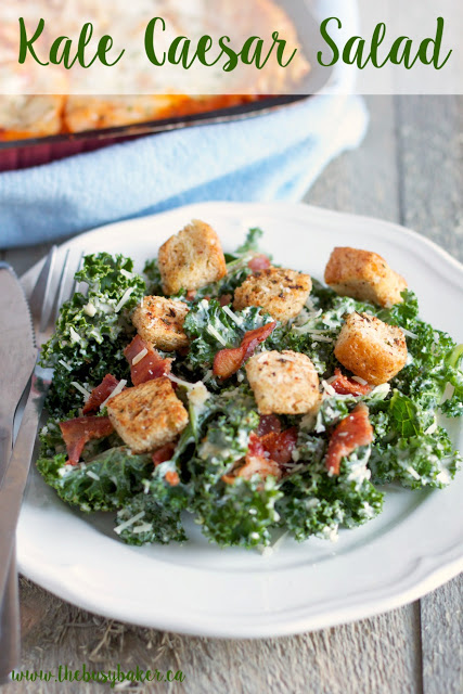 kale Caesar salad topped with homemade croutons and bacon