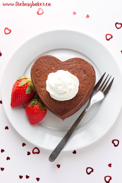 a plate of low fat heart shaped buttermilk pancakes topped with whipped cream