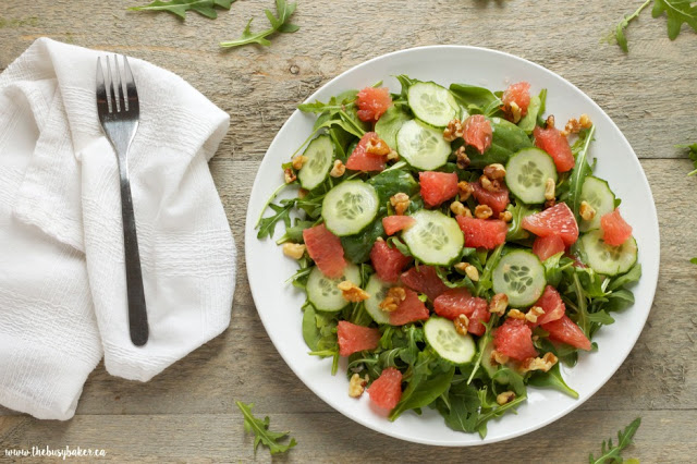 plate of grapefruit walnut arugula salad