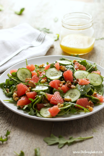 healthy arugula salad with fresh grapefruit, cucumbers, and honey-lemon vinaigrette dressing