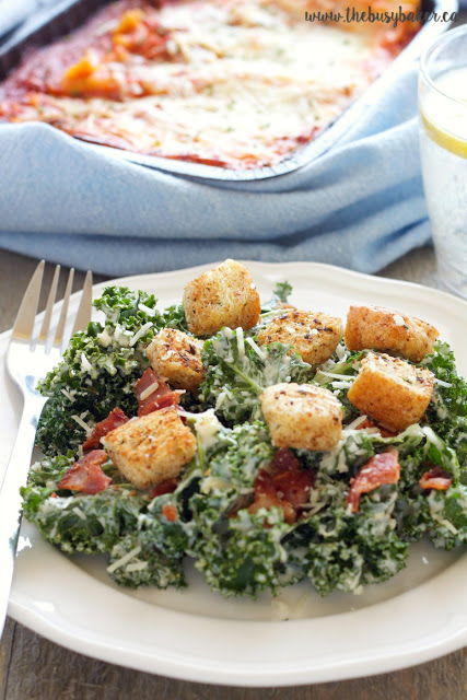 Kale Caesar salad topped with bacon and croutons