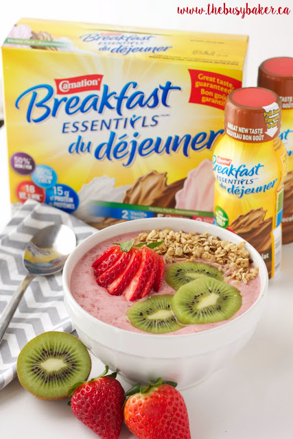 a strawberry kiwi smoothie bowl next to a box of Carnation Breakfast Essentials