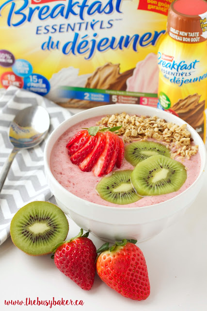 healthy breakfast smoothie bowl made from strawberries, kiwi, and Carnation Breakfast Essentials drink mix