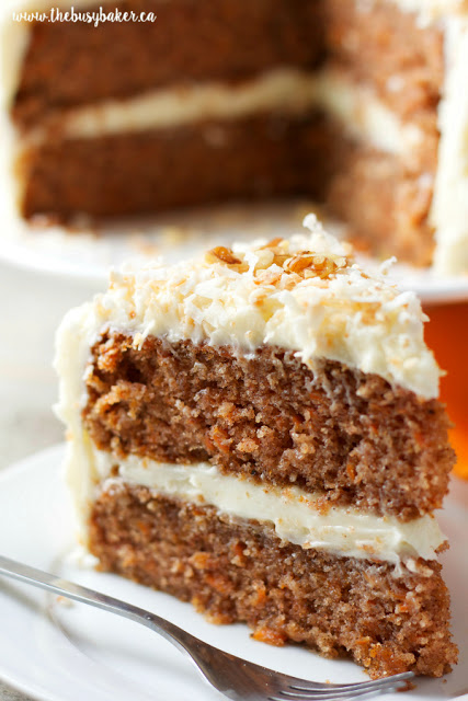 slice of classic carrot cake with cream cheese frosting