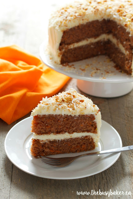 homemade carrot cake topped with nuts