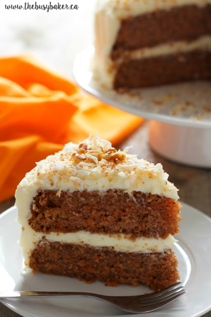 slice of 2-layer carrot cake with cream cheese frosting
