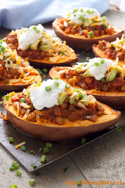 vegan chili stuffed sweet potatoes topped with sour cream