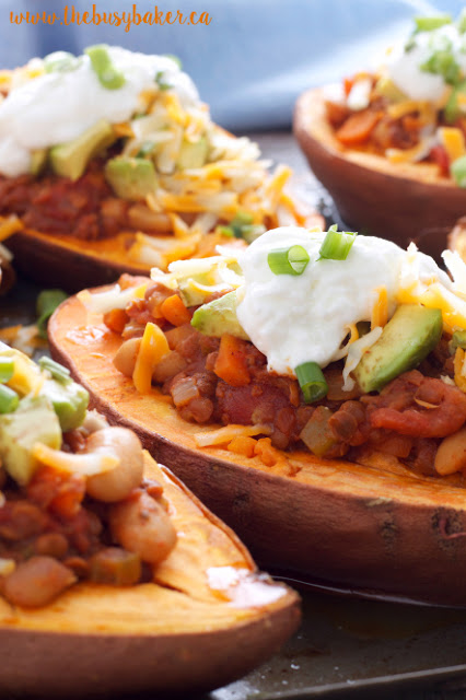 baked sweet potatoes stuffed with meatless lentil and white bean chili
