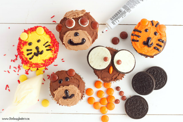 Zoo Animal Cupcakes - a monkey cupcake, bear cupcake, tiger cupcake, owl cupcake, and lion cupcake