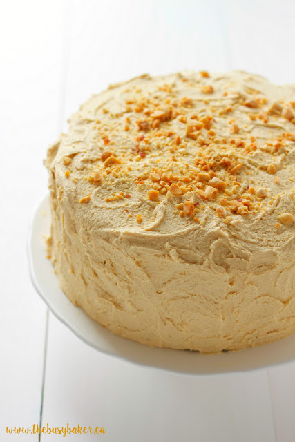 moist banana cake topped with fluffy peanut butter frosting and crushed peanuts