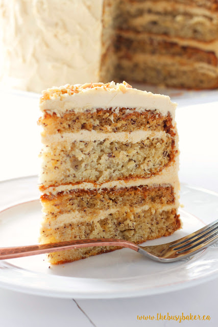 Banana Layer Cake with Fluffy Peanut Butter Frosting on a dessert plate with a fork