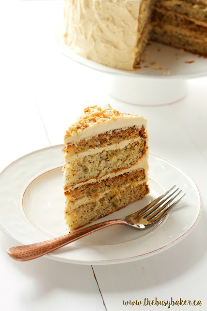 a slice of banana layer cake topped with peanut butter frosting