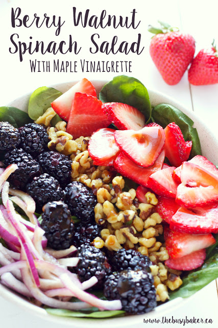 This healthy summer Berry Walnut Spinach Salad with Maple Vinaigrette is made with fresh spinach, berries and walnuts and an easy-to-make maple dressing! Recipe from thebusybaker.ca!