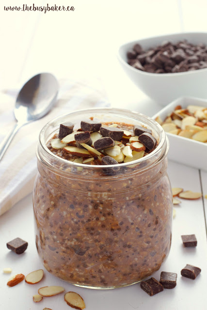 individual jar of overnight oats with chocolate, chia seeds and almonds