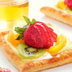 vanilla bean custard fruit tart with honey glazed fruit