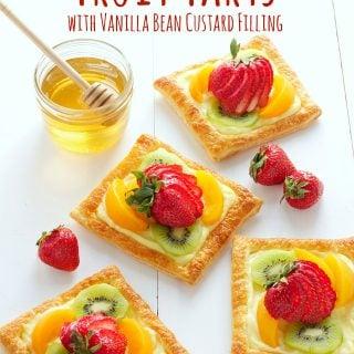 titled image (and shown) Honey Glazed Fruit Tarts with Vanilla Bean Custard Filling