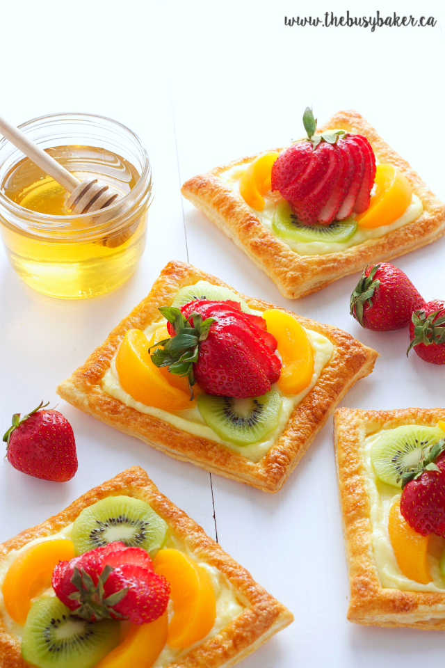 vanilla custard fruit tarts topped with honey glazed fruit
