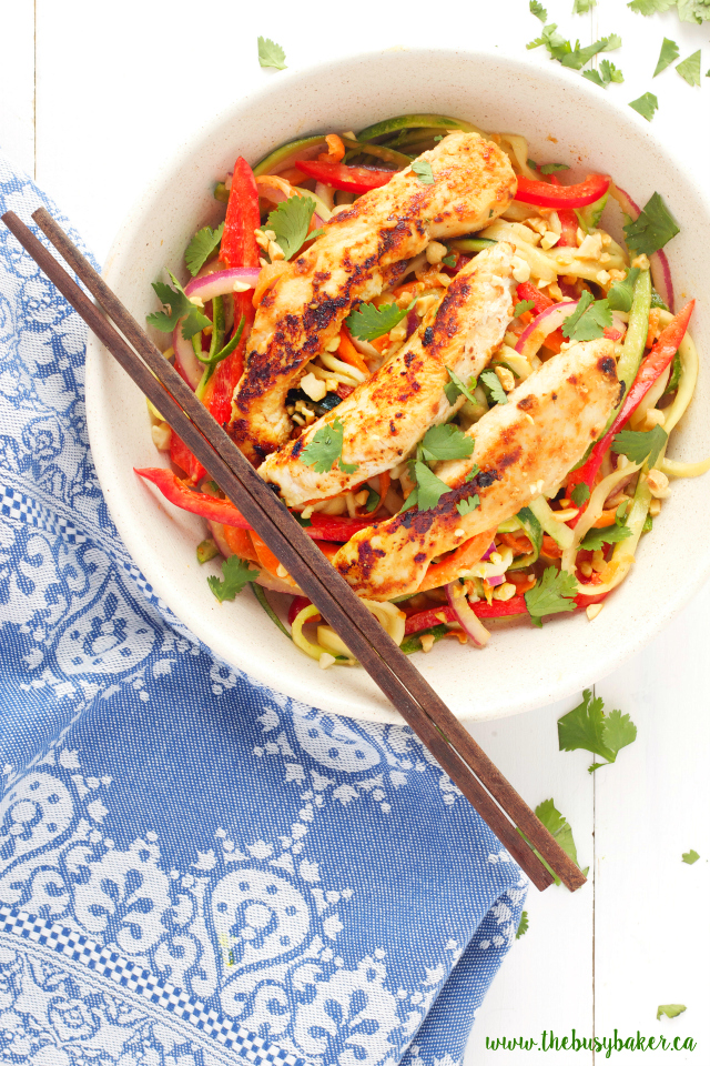 This Thai Chicken Spiralized Zucchini Salad is a healthy Asian-inspired meal featuring grilled chicken breast, spiralized veggies, and an easy peanut sauce! Recipe from www.thebusybaker.ca