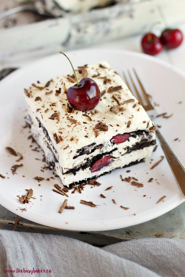 This No Bake Black Forest Icebox Cake is super creamy and sweet featuring fresh cherries, and you'll only need 4 simple ingredients to make it! Recipe from thebusybaker.ca!