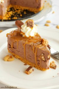 a slice of Snickers no bake cheesecake