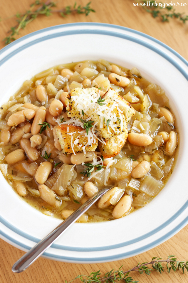 Bowl of Slow Cooker French Onion Soup with white beans and fresh thyme