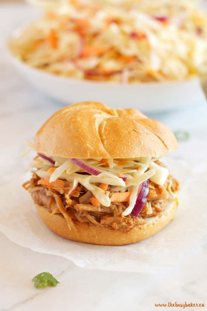 These Easy Slow Cooker Barbecue Pulled Pork Sandwiches feature a super easy 3-ingredient Slow Cooker Pulled Pork with an easy homemade coleslaw! Recipe from thebusybaker.ca!