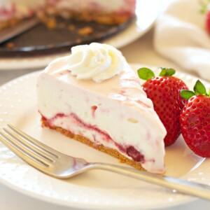 slice of no bake strawberry swirl cheesecake