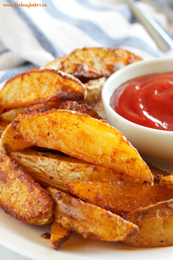 These Crispy Barbecue Potato Wedges are the perfect summer side dish - crispy on the outside and soft on the inside, with deliciously smoky BBQ flavor! Recipe from thebusybaker.ca!