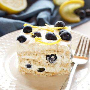 This No Bake Lemon Blueberry Icebox Cake is the perfect summer dessert made from only 5 simple ingredients, featuring a creamy, sweet lemon filling and fresh, juicy blueberries! Recipe from thebusybaker.ca!