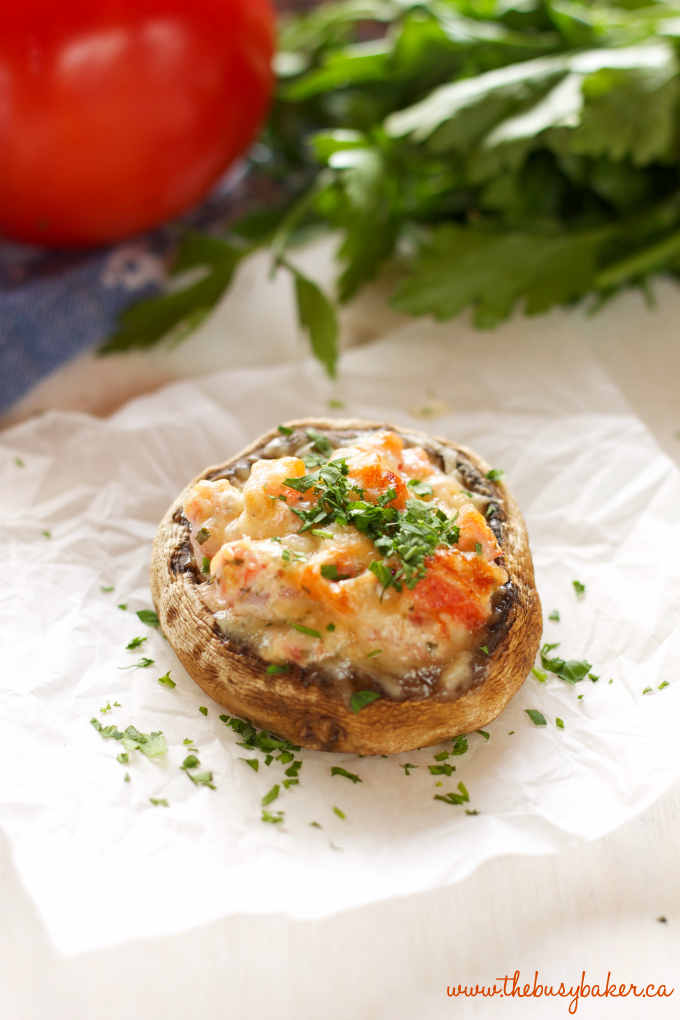 These Creamy Bruschetta Stuffed Mushrooms are the perfect easy appetizer packed with fresh tomatoes and herbs, and 3 delicious cheeses! Recipe by thebusybaker.ca!