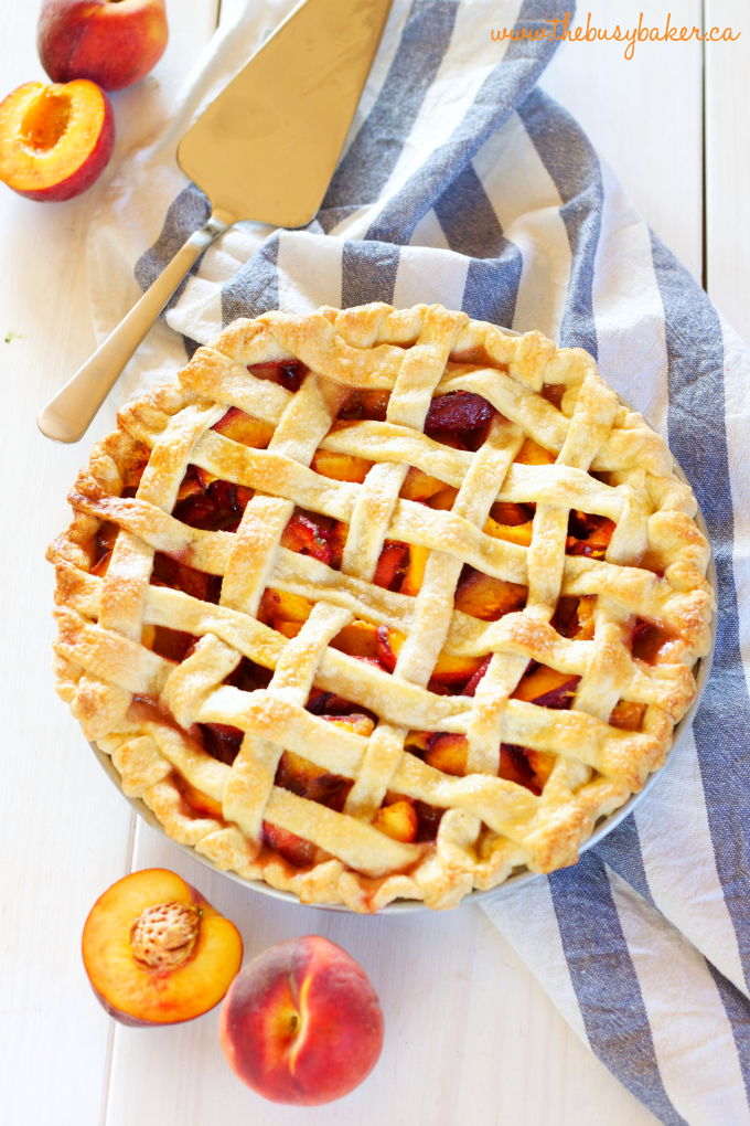 This Easy Classic Peach Pie recipe is simple and rustic, made with a butter crust and fresh peaches. Recipe includes my pro tips for the perfect pie every time! www.thebusybaker.ca