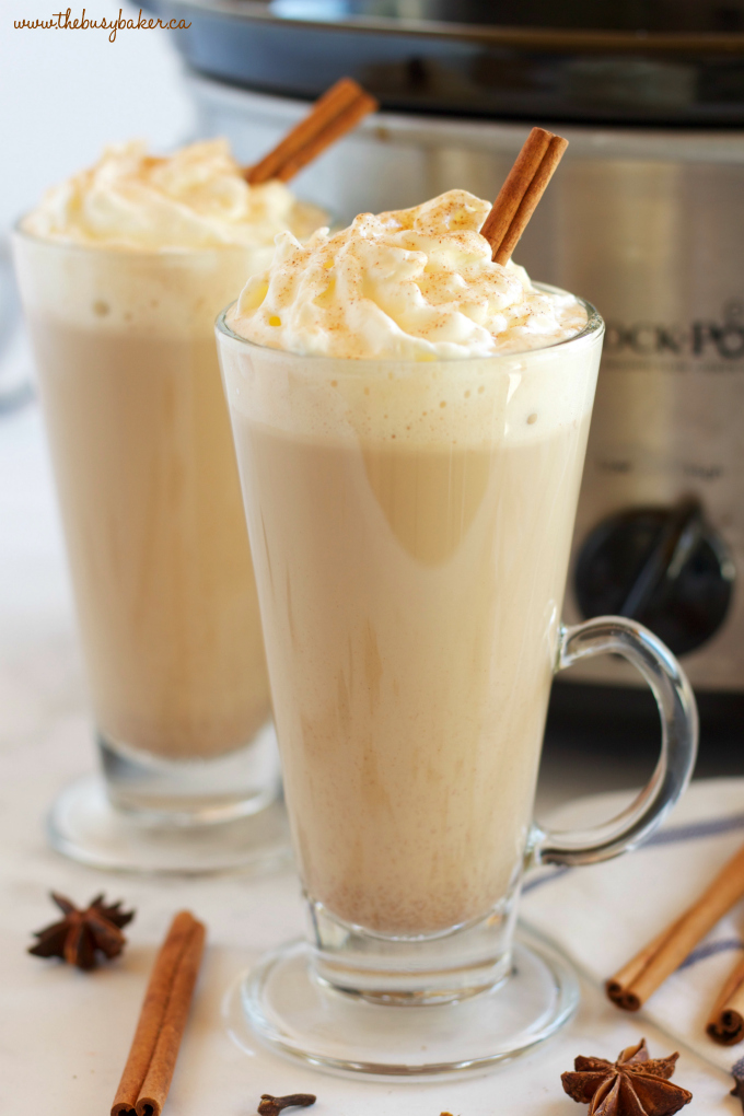 This Slow Cooker Pumpkin Spice Latte is the perfect warm fall drink with everybody's favorite pumpkin spice flavors - it's easy to make in the Crock Pot or slow cooker, and it's great for parties! Recipe from thebusybaker.ca!