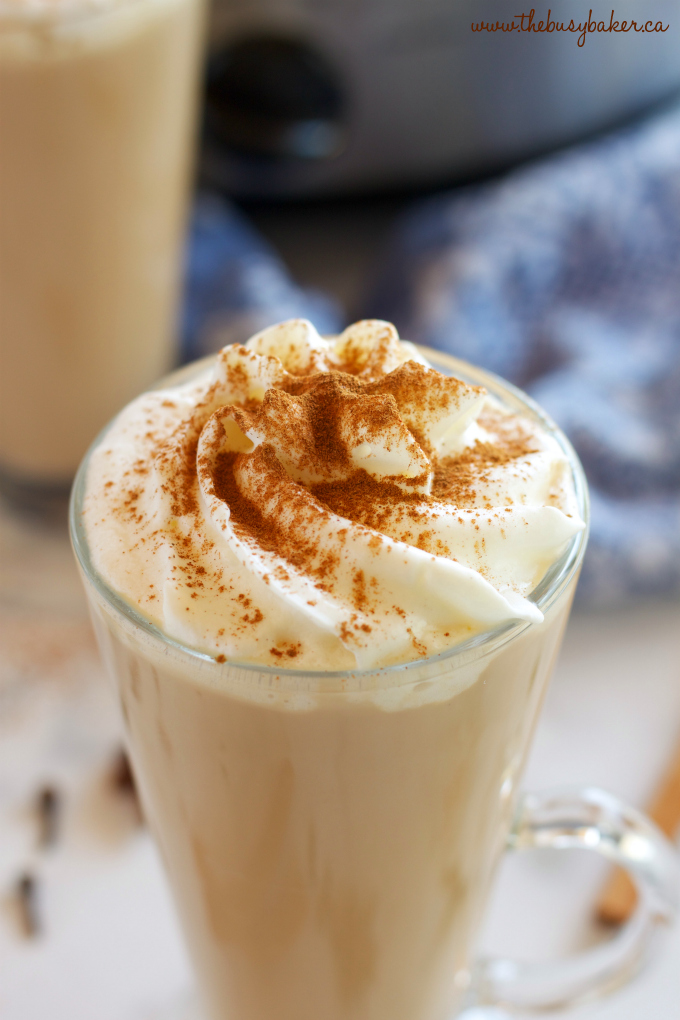 This Slow Cooker Chai Tea Latte is the perfect healthier warm drink for the holidays, and it's so easy to make with only a few simple ingredients! Recipe from thebusybaker.ca! #chailatte #homemadechailatte #slowcookerlatte #crockpotlatte