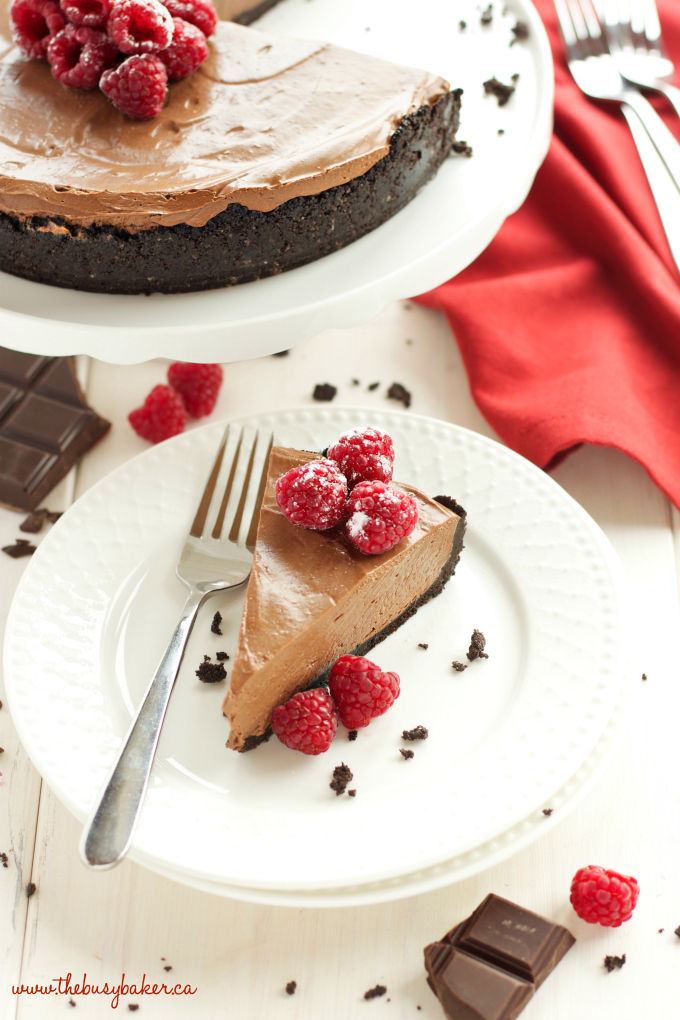 This No Bake Chocolate Mousse Cheesecake is the ultimate vegan and dairy-free chocolate dessert that's so smooth and creamy, made with a secret ingredient! Recipe from thebusybaker.ca #vegancheesecake #veganchocolatedessert #dairyfreedessert #dairyfreecheesecake #besteverchocolatecheesecake