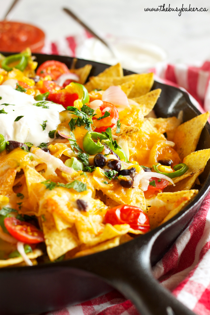 Healthy Vegetarian Nachos with veggies in skillet and low fat cheese