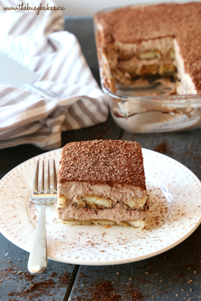 This Chocolate Mocha Tiramisu Icebox Cake is the perfect easy no bake dessert for coffee and chocolate lovers! Made with simple, basic ingredients and bursting with deep chocolate and coffee flavours, this is a no bake dessert that's a definite crowd pleaser! Recipe from thebusybaker.ca! #easytiramisurecipe #chocolatetiramisu #nobaketiramisu #nobakecoffeedessert