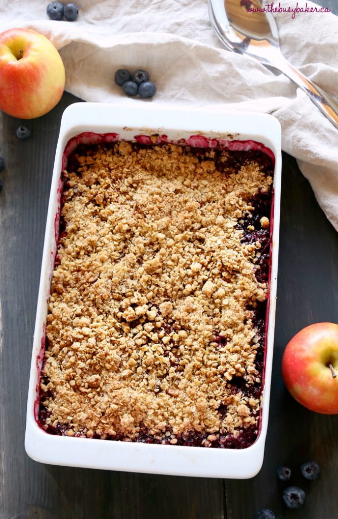 This Easy Apple Berry Fruit Crisp is the perfect easy dessert for beginning bakers! Just a few simple ingredients stand between you and this delicious, healthier dessert! Make it with fresh or frozen fruit, and gluten-free! Recipe from thebusybaker.ca! #howtomakeapplecrisp #easyapplecrisp #fruitcrisp #healthydessert
