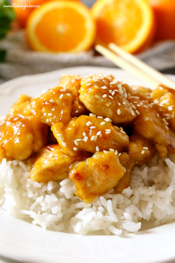 This Easy Healthier Sesame Orange Chicken is the perfect Asian-inspired weeknight meal that's better than take-out and a healthy choice for the whole family! Make it in 15 minutes or less! Recipe from thebusybaker.ca! #orangechicken #easystirfry #weeknightmeal #15minutemeal