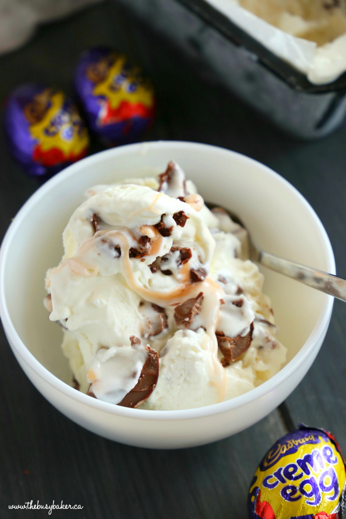 This Easy No Churn Creme Egg Ice Cream is so easy to make with only 3 ingredients! It's the perfect simple treat for spring featuring everybody's favourite Easter chocolate candy - Cadbury Creme Eggs! Recipe from thebusybaker.ca! #cremeeggdessert #cremeeggicecream #easynochurnicecream #easyhomemadeicecream