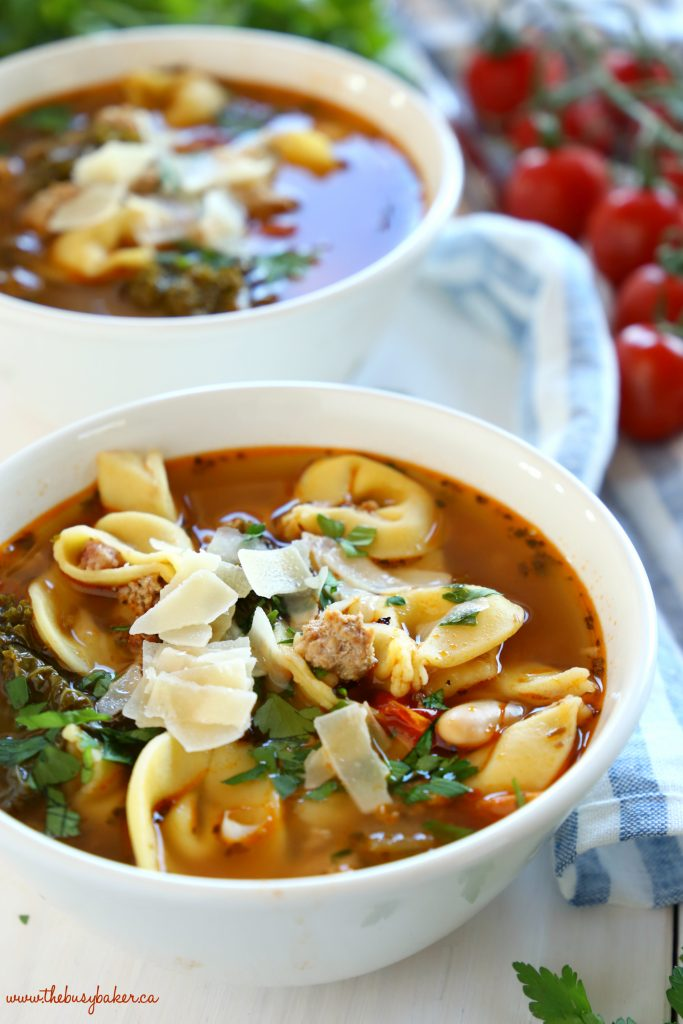 This Rustic Italian Sausage Tortellini Soup is packed with fresh, wholesome ingredients and bursting with Italian flavours. It's hearty, filling, and is so easy to make! Recipe from thebusybaker.ca! #italiansoup #tortellinisoup #rusticsoup #easysouprecipe