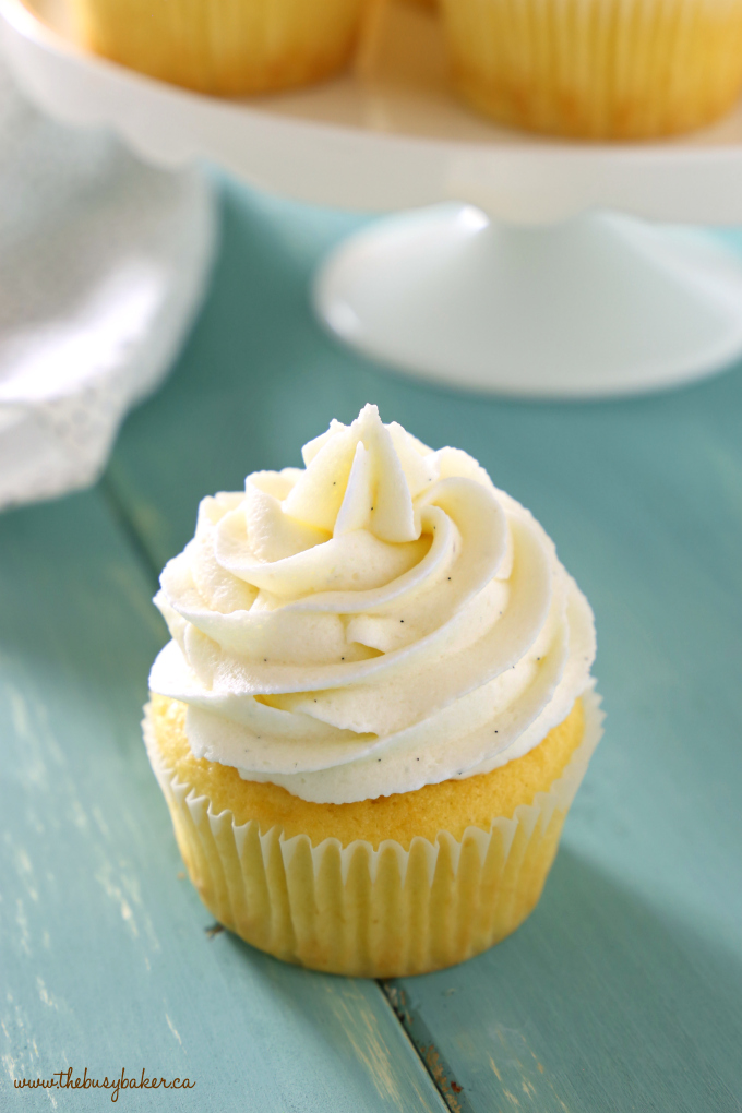 These Vanilla Bean Cupcakes are tender and fluffy and topped with ultra creamy mascarpone buttercream frosting made with real vanilla beans! They're perfect for parties, birthdays, or any occasion at all! Recipe from thebusybaker.ca! #bestevervanillacupcakes #easyvanillacupcakes #vanillabeancupcakerecipe