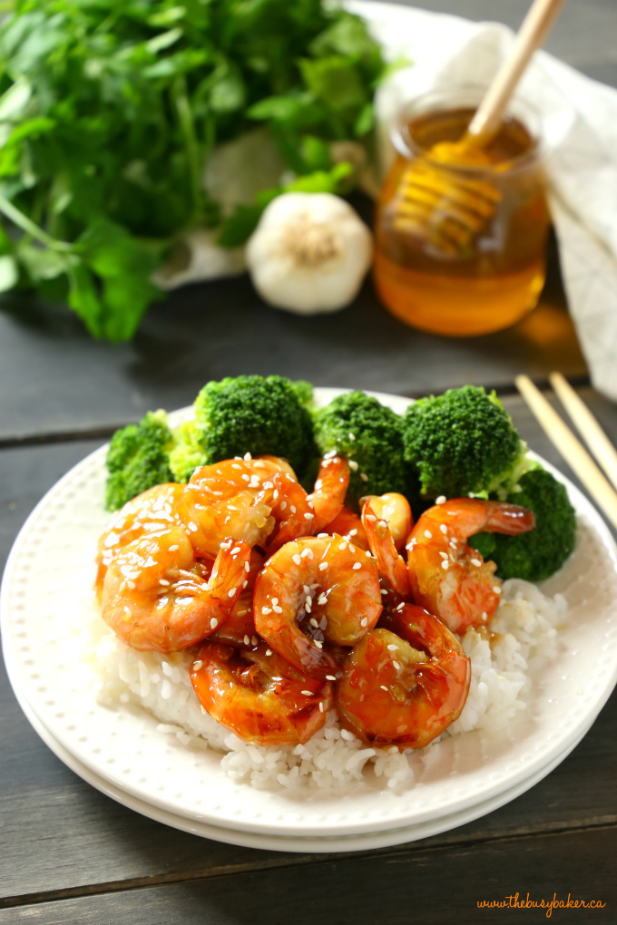 This Easy One Pan Honey Garlic Shrimp is a delicious Asian-inspired meal idea with the perfect honey garlic sauce. And it's made with simple ingredients in 15 minutes or less! Recipe from thebusybaker.ca! #easyhoneygarlicsauce #honeygarlicshrimp #15minutemeal